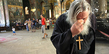 Ce simbolizeaza semnul Crucii savarsit de credinciosi?